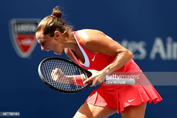 Roberta Vinci of Italy celebrates after winning her second set against Serena Williams of the United States during their Women's Singles Semifinals...