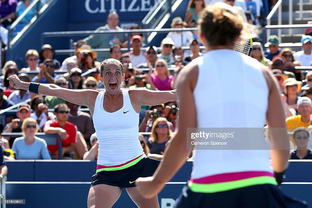 Roberta Vinci of Italy celebrates match point next to Sara Errani following their victory against Andrea Hlavackova and Lucie Hradecka of the Czech...