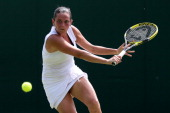 Roberta Vinci of Italy hits a backhand return during her Ladies' Singles second round match against Marina Erakovic of New Zealand on day four of the...