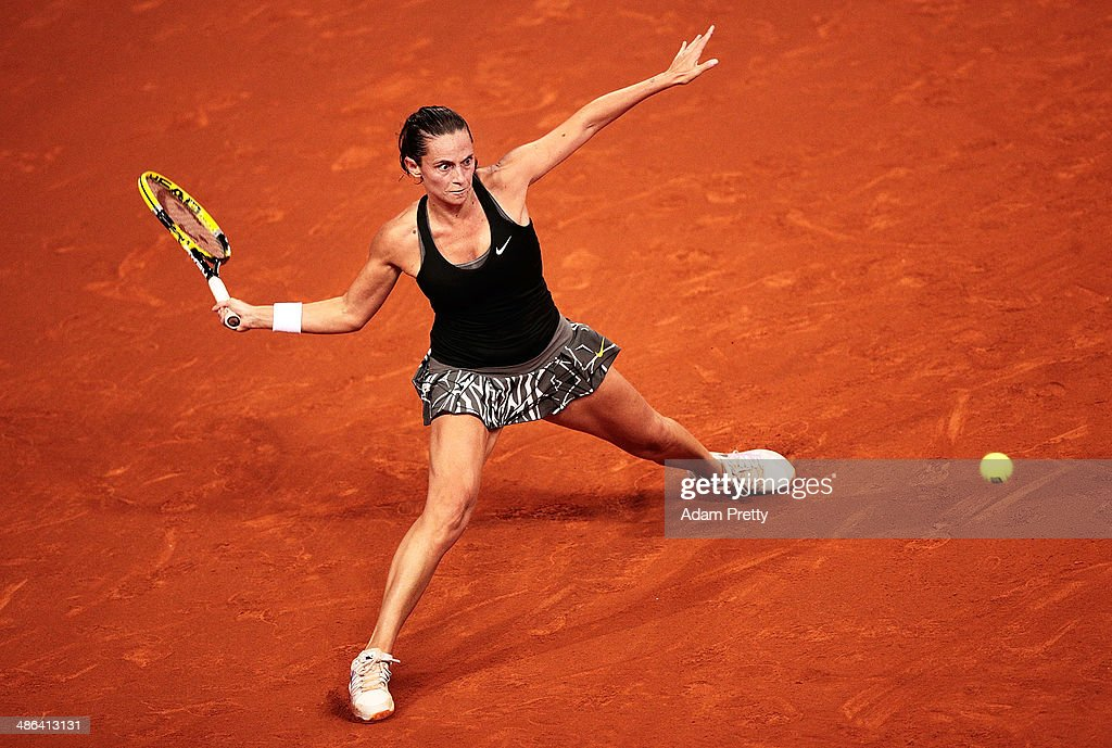 <a gi-track='captionPersonalityLinkClicked' href=/galleries/search?phrase=Roberta+Vinci&family=editorial&specificpeople=633555 ng-click='$event.stopPropagation()'>Roberta Vinci</a> of Italy hits a forehand during her match against Agnieszka Radwanska of Poland on day four of the Porsche Tennis Grand Prix 2014 at Porsche Arena on April 24, 2014 in Stuttgart, Germany.