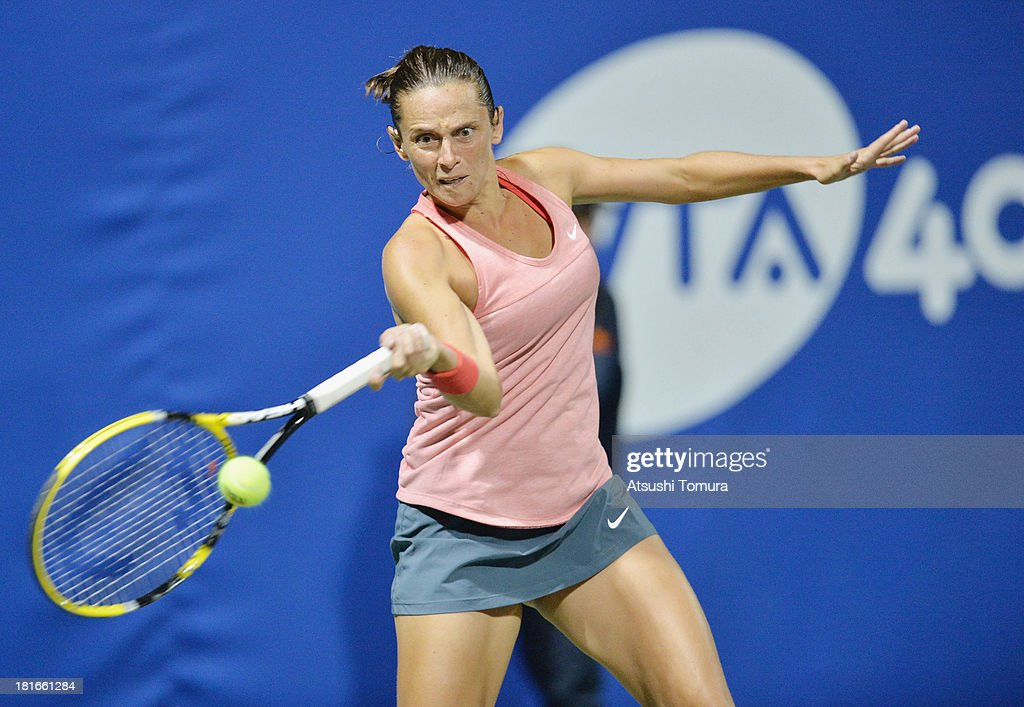 <a gi-track='captionPersonalityLinkClicked' href=/galleries/search?phrase=Roberta+Vinci&family=editorial&specificpeople=633555 ng-click='$event.stopPropagation()'>Roberta Vinci</a> of Italy in action during her women's singles second round match against Lucie Safarova of Czech Republic during day two of the Toray Pan Pacific Open at Ariake Colosseum on September 23, 2013 in Tokyo, Japan.