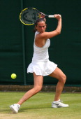 Roberta Vinci of Italy plays a backhand during the Ladies' Singles second round match against Jana Cepelova of Slovakia on day four of the Wimbledon...
