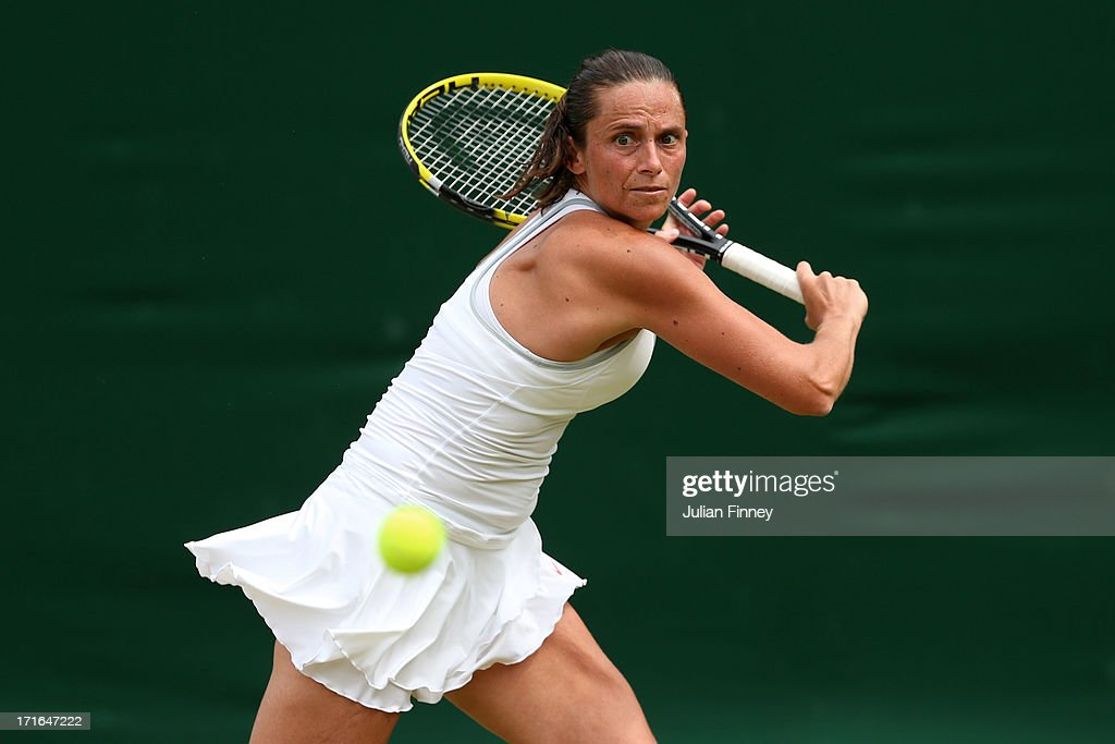 Roberta Vinci of Italy plays a backhand during the Ladies' Singles second round match against Jana Cepelova of Slovakia on day four of the Wimbledon Lawn Tennis Championships at the All England Lawn Tennis and Croquet Club on June 27, 2013 in London, England.
