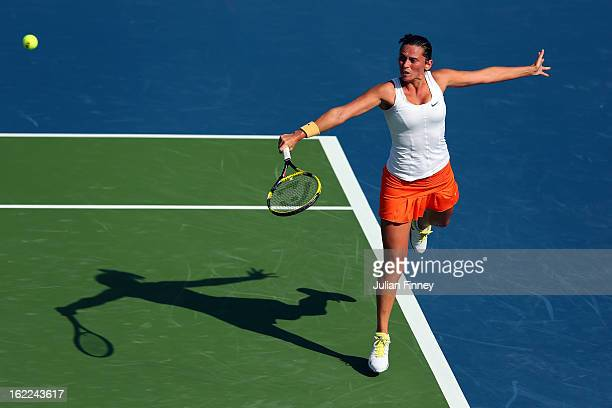 Roberta Vinci of Italy plays a backhand in her match against Samantha Stosur of Australia during day four of the WTA Dubai Duty Free Tennis...