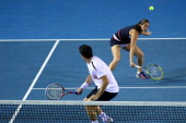 Roberta Vinci of Italy plays a backhand in her semifinal mixed doubles match with Daniele Bracciali of Italy against Leander Paes of India and Elena...