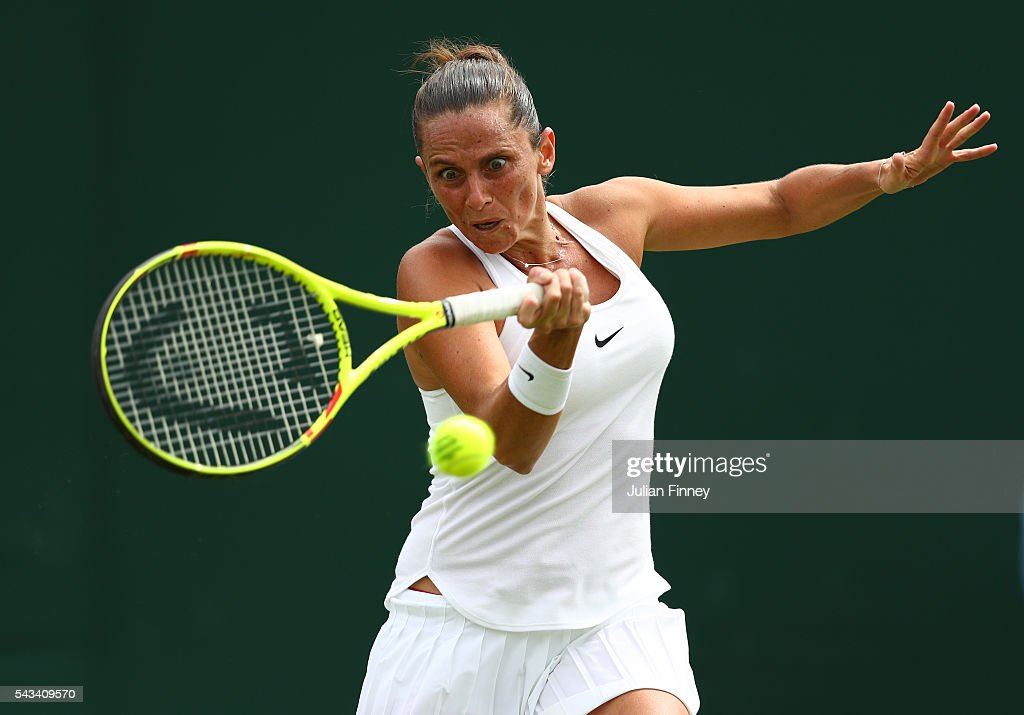 <a gi-track='captionPersonalityLinkClicked' href=/galleries/search?phrase=Roberta+Vinci&family=editorial&specificpeople=633555 ng-click='$event.stopPropagation()'>Roberta Vinci</a> of Italy plays a forehand during the Ladies Singles first round match against Alison Riske of The United States on day two of the Wimbledon Lawn Tennis Championships at the All England Lawn Tennis and Croquet Club on June 28, 2016 in London, England.
