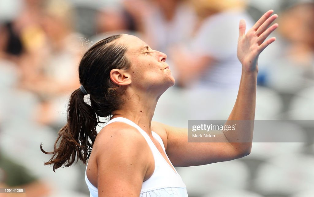 <a gi-track='captionPersonalityLinkClicked' href=/galleries/search?phrase=Roberta+Vinci&family=editorial&specificpeople=633555 ng-click='$event.stopPropagation()'>Roberta Vinci</a> of Italy reacts after a point in her quaterfinal match against Agnieszka Radwanska of Poland during day four of the Sydney International at Sydney Olympic Park Tennis Centre on January 9, 2013 in Sydney, Australia.