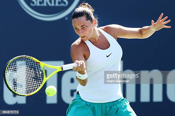 Roberta Vinci of Italy returns a shot during her match against Ana Konjuh of Croatia on day 4 of the Connecticut Open at the Connecticut Tennis...