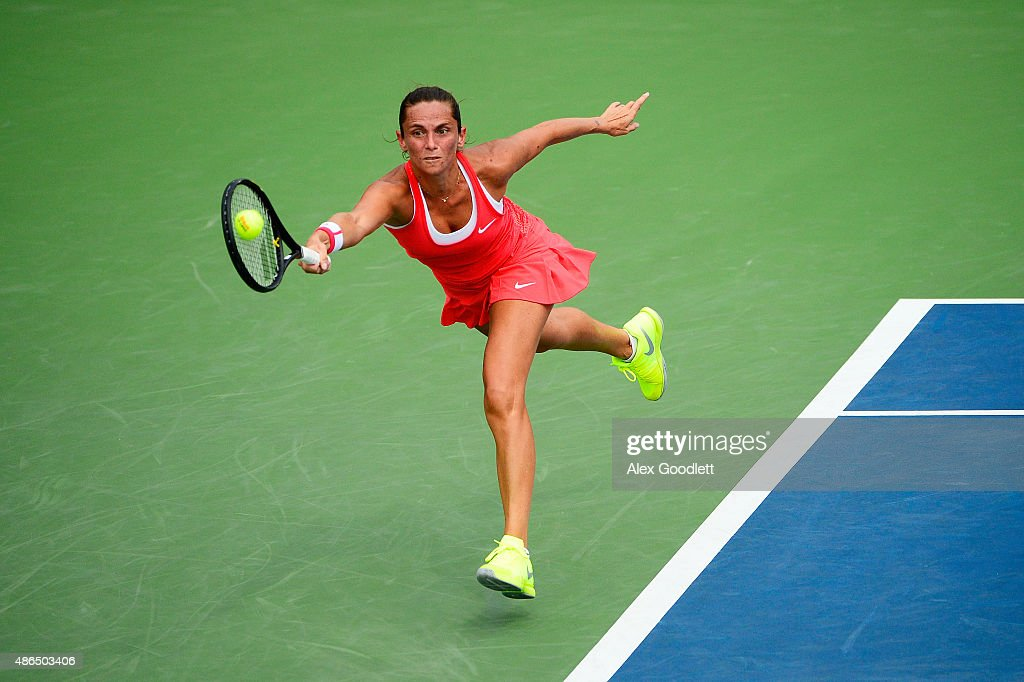 <a gi-track='captionPersonalityLinkClicked' href=/galleries/search?phrase=Roberta+Vinci&family=editorial&specificpeople=633555 ng-click='$event.stopPropagation()'>Roberta Vinci</a> of Italy returns a shot to Mariana Duque-Marino of Colombia during their Women's Singles Third Round match on Day Five of the 2015 US Open at the USTA Billie Jean King National Tennis Center on September 4, 2015 in the Flushing neighborhood of the Queens borough of New York City.