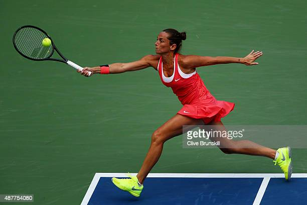 Roberta Vinci of Italy returns a shot to Serena Williams of the United States during their Women's Singles Semifinals match on Day Twelve of the 2015...