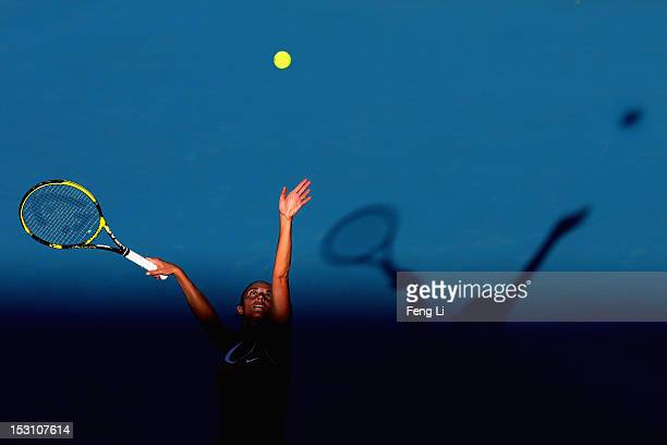 Roberta Vinci of Italy serves against Lourdes Dominguez Lino of Spain during the Day 2 of China Open at the China National Tennis Center on September...