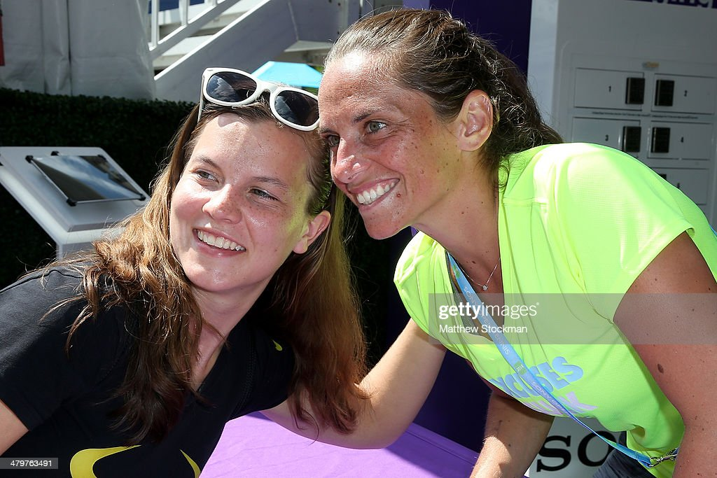 Roberta Vinci of Italy signs autographs and poses for pictures at the Sony booth during the Sony Open at the Crandon Park Tennis Center on March 20, 2014 in Key Biscayne, Florida.