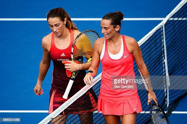 Roberta Vinci of Italy talks to Mariana DuqueMarino of Colombia after ahe defeated her in their Women's Singles Third Round match on Day Five of the...
