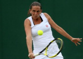 Roberta Vinci of of Italy hits a backhand return during her Ladies' singles fourth round match against Tamira Paszek of Austria day seven of the...