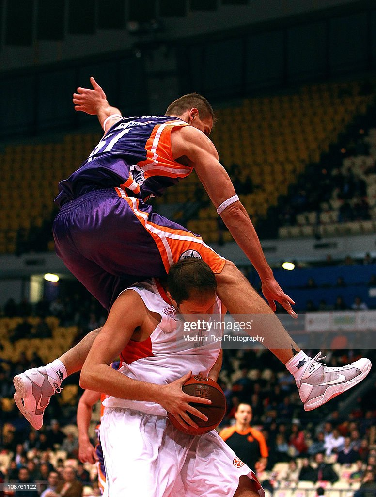 Robertas Javtokas of Valencia jumps on Rasho Nesterovic of Olympiacos during the 2010-2011 Turkish Airlines Euroleague Top 16 Date 3 game between Olympiacos Piraeus vs Power Electronics Valencia at Peace and Friendship Stadium on February 2, 2011 in Athens, Greece.