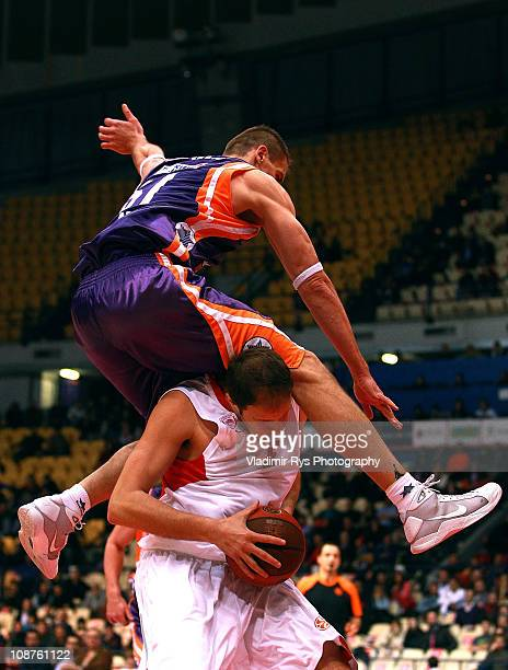 Robertas Javtokas of Valencia jumps on Rasho Nesterovic of Olympiacos during the 20102011 Turkish Airlines Euroleague Top 16 Date 3 game between...