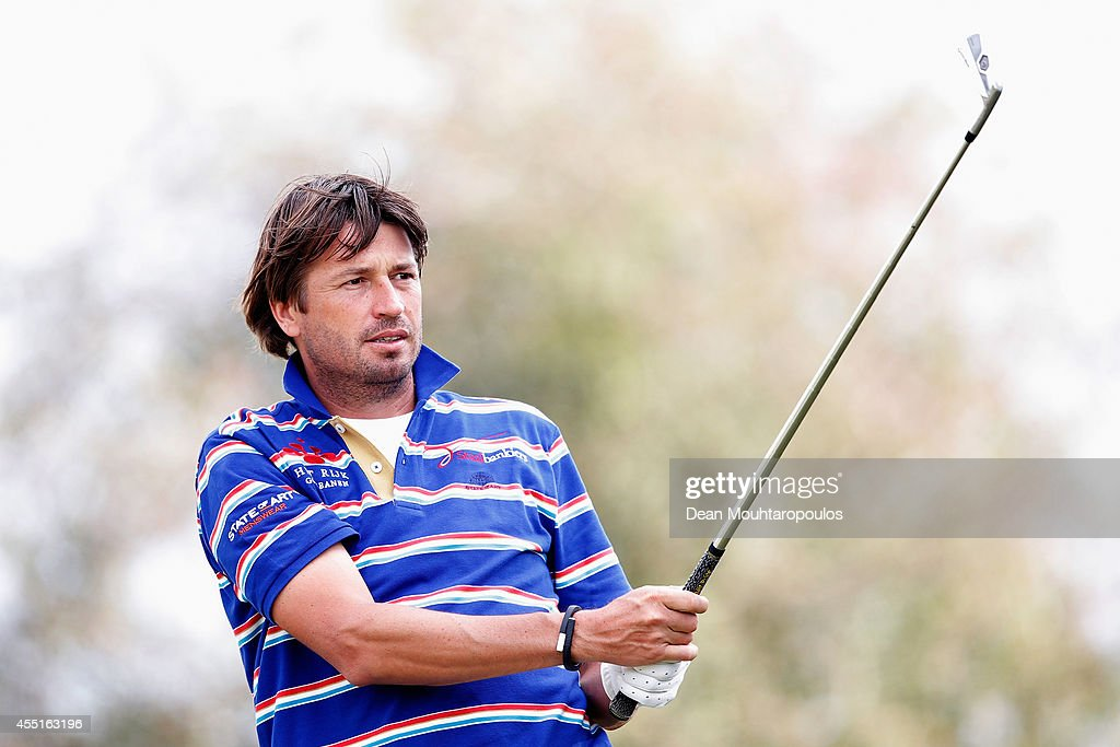 RobertJan Derksen of the Netherlands looks on after he hits a shot during the KLM Open ProAm held at De Kennemer Golf and Country Club on September...