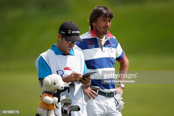RobertJan Derksen of The Netherlands speaks to his caddie before he hits his second shot on the 1st hole during the final round of the Open de Espana...