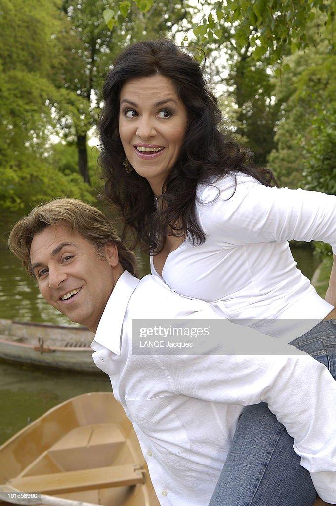 <a gi-track='captionPersonalityLinkClicked' href=/galleries/search?phrase=Roberto+Alagna&family=editorial&specificpeople=679931 ng-click='$event.stopPropagation()'>Roberto Alagna</a> With His Companion <a gi-track='captionPersonalityLinkClicked' href=/galleries/search?phrase=Angela+Gheorghiu&family=editorial&specificpeople=581633 ng-click='$event.stopPropagation()'>Angela Gheorghiu</a> In Bois De Boulogne. Attitude souriante du ténor Roberto ALAGNA portant sur son dos sa compagne la soprano Angela GHEORGHIU devant des barques au bord du lac du bois de Boulogne.