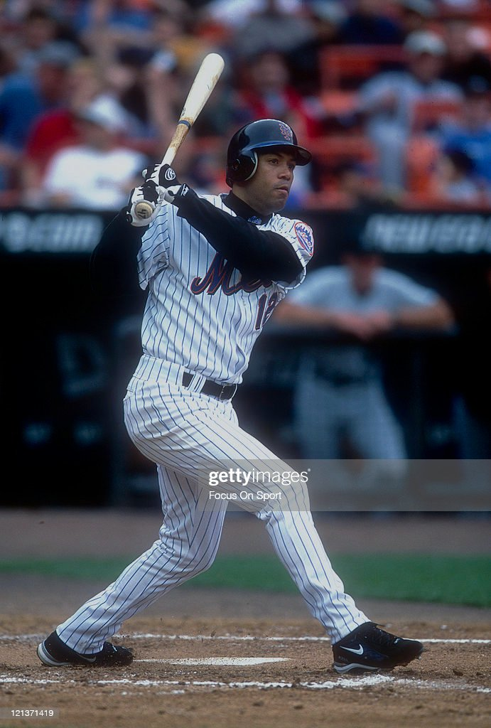 Roberto Alomar #12 of the New York Mets bats during an Major League Baseball game circa 2002 at Shea Stadium in the Queens borough of New York City. Alomar played for the Mets from 2002-2003.
