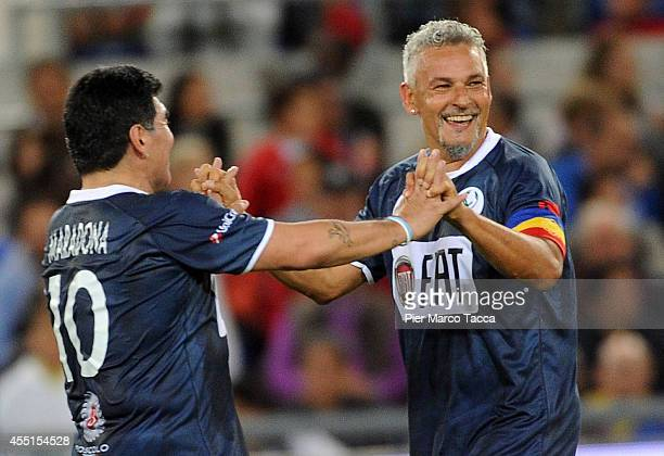 Roberto Baggio and Diego Maradona celebrate the goal during the Interreligious Match for Peace at Olimpico Stadium on September 1 2014 in Rome Italy