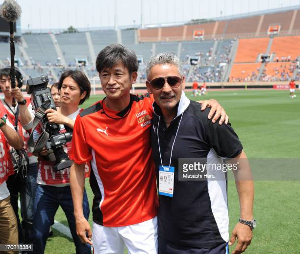 Roberto Baggio and Kazuyoshi Miura look on prior to the JLeague Legend and Glorie Azzurre match at the National Stadium on June 9 2013 in Tokyo Japan