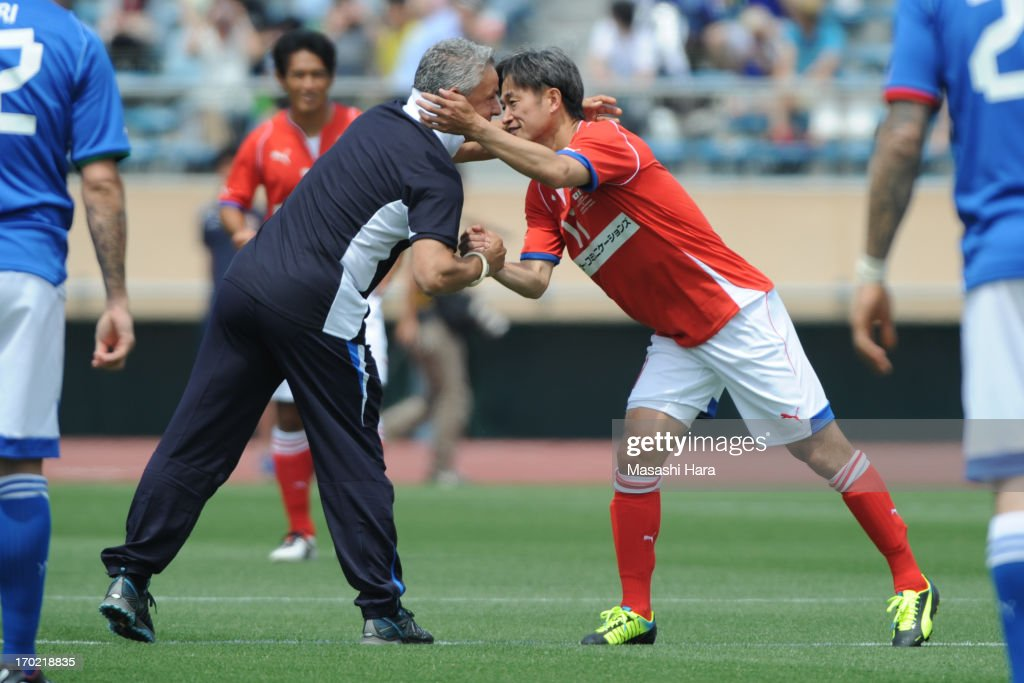 Roberto Baggio (L) and Kazuyoshi Miura look on prior to the J.League Legend and Glorie Azzurre match at the National Stadium on June 9, 2013 in Tokyo, Japan.