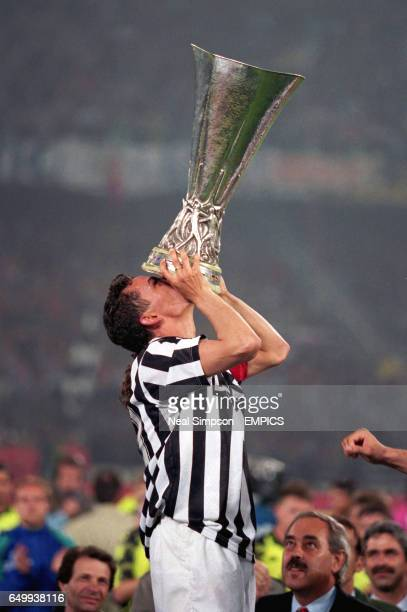 Roberto Baggio lifts and kisses the UEFA Cup for Juventus