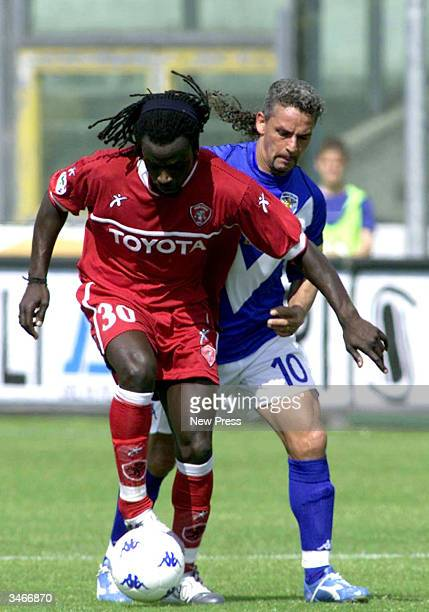 Roberto Baggio of Brescia attempts to steal from Ferdinand Coly of Perugia in their game on April 25 2004 in Brescia Italy