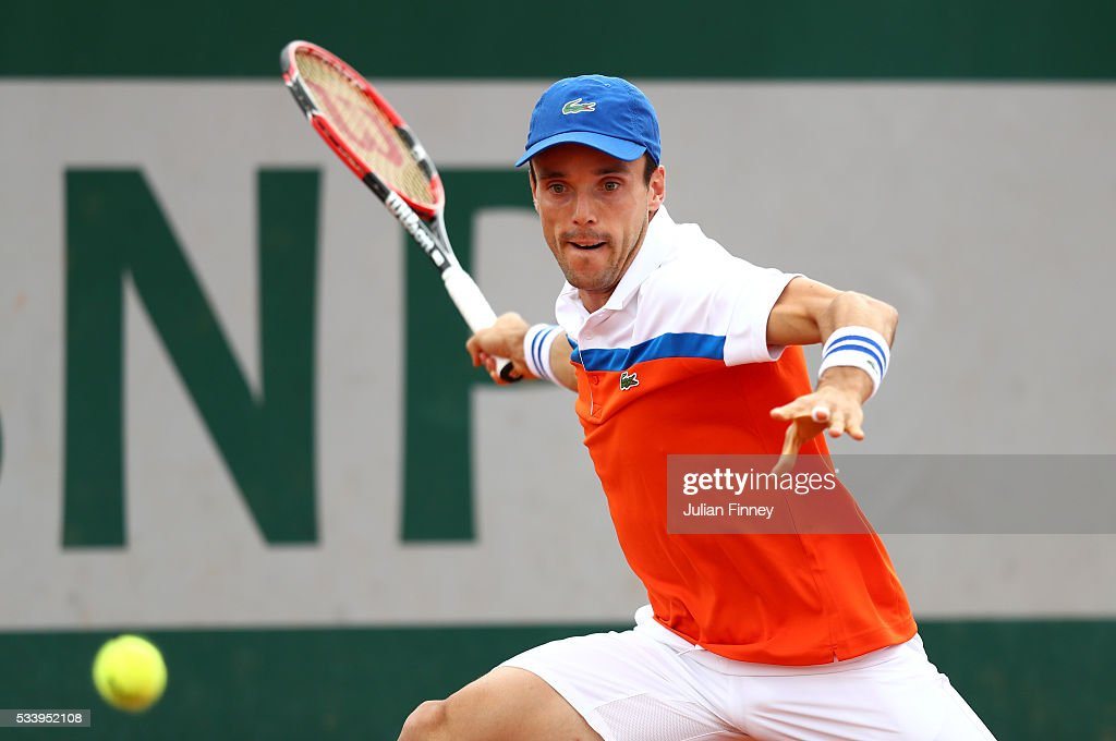 Roberto Baustista Agut of Spain plays a forehand during the Men's Singles first round match against Dimitry Tursunov of Russia on day three of the 2016 French Open at Roland Garros on May 24, 2016 in Paris, France.