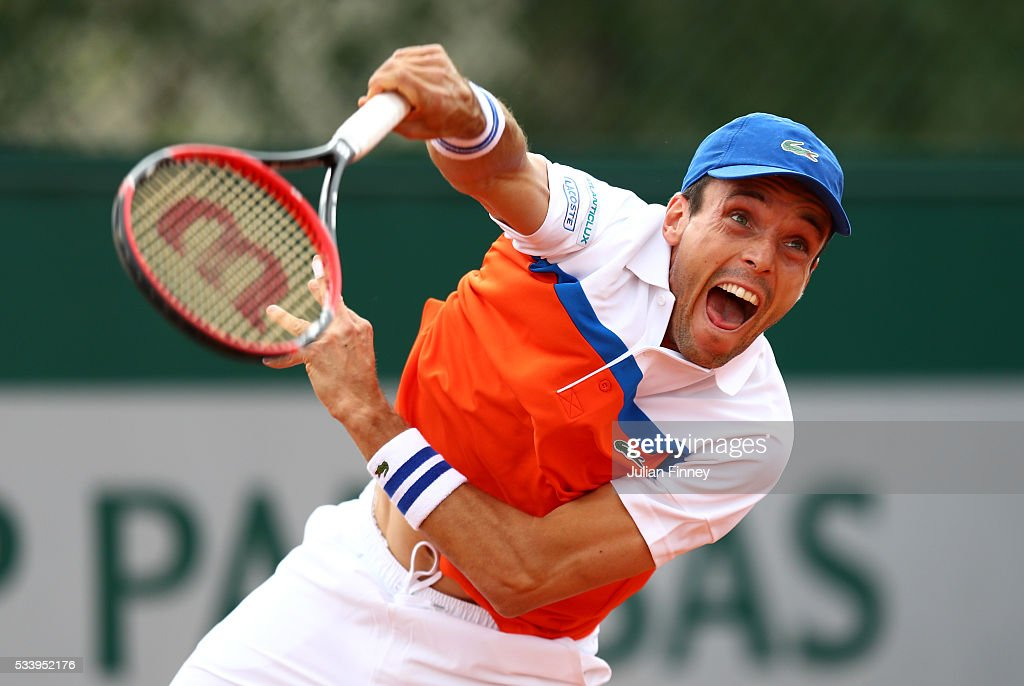 Roberto Baustista Agut of Spain serves during the Men's Singles first round match against Dimitry Tursunov of Russia on day three of the 2016 French Open at Roland Garros on May 24, 2016 in Paris, France.