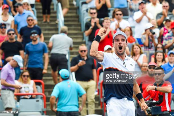 Roberto Bautista Agut celebrates his win with the crowd cheering during his third round match at ATP Coupe Rogers on August 10 at Uniprix Stadium in...