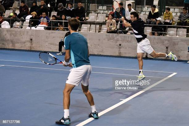 Roberto Bautista Agut of Spain and Aljaz Bedene of Great Britain in action against Lucas Pouille of France and Fernando Verdasco of Spain during...