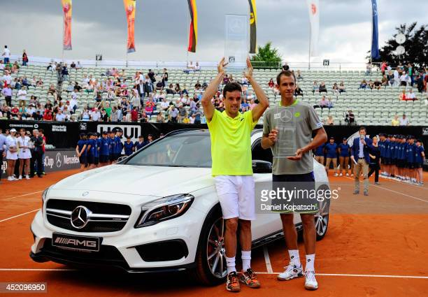 Roberto Bautista Agut of Spain and Lukas Rosol of Czech Republic pose after their final match on day seven of MercedesCup at TC Weissenhof on July 13...