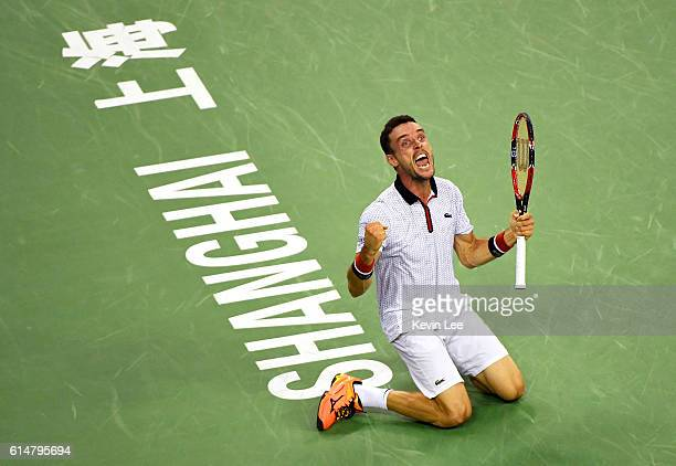 Roberto Bautista Agut of Spain celebrates after defeating Novak Djokovic of Serbia after their MenÕs Single SemiFinal match in ATP Shanghai Rolex...