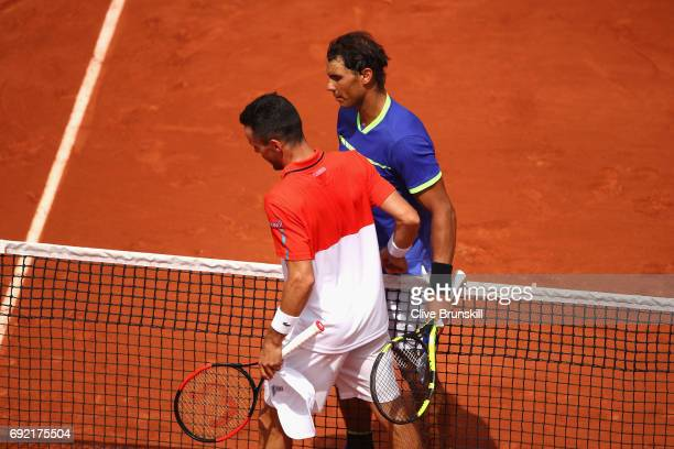 Roberto Bautista Agut of Spain congratulates Rafael Nadal of Spain on victory following the mens singles fourth round match on day eight of the 2017...