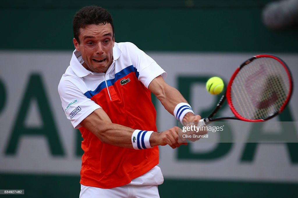 Roberto Bautista Agut of Spain hits a backhand during the Men's Singles third round match against Borna Coric of Croatia on day seven of the 2016 French Open at Roland Garros on May 28, 2016 in Paris, France.