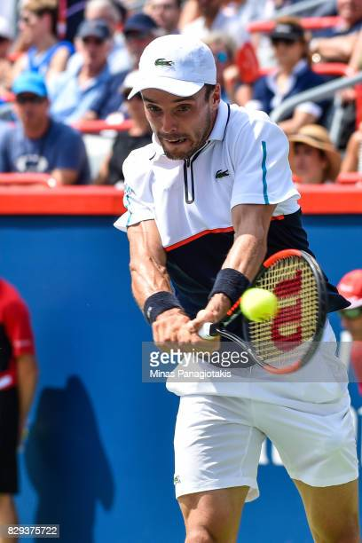 Roberto Bautista Agut of Spain hits a return against Gael Monfils of France during day seven of the Rogers Cup presented by National Bank at Uniprix...
