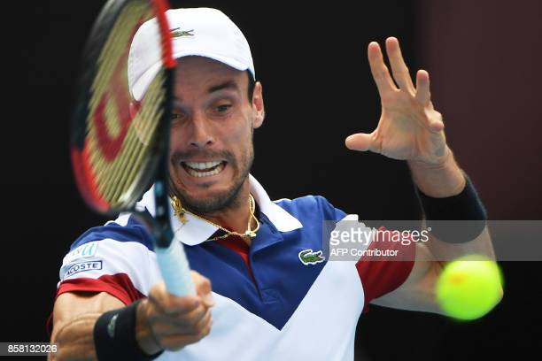 Roberto Bautista Agut of Spain hits a return during his men's singles quarterfinal against Grigor Dimitrov of Bulgaria at the China Open tennis...