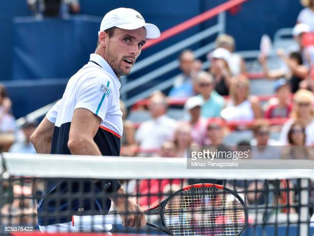 Roberto Bautista Agut of Spain looks on after scoring a point against Gael Monfils during day seven of the Rogers Cup presented by National Bank at...