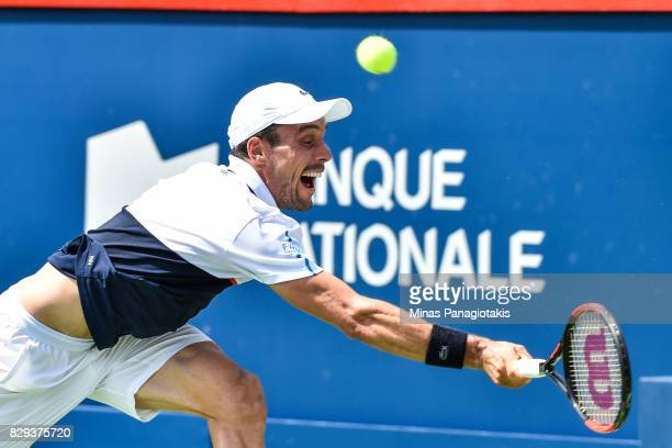 Roberto Bautista Agut of Spain misses the ball against Gael Monfils of France during day seven of the Rogers Cup presented by National Bank at...