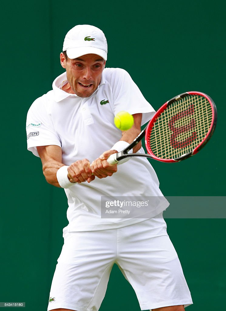 Roberto Bautista Agut of Spain plays a backhand during the Men's Singles first round match against Jordan Thompson of Australia on day two of the Wimbledon Lawn Tennis Championships at the All England Lawn Tennis and Croquet Club on June 28, 2016 in London, England.