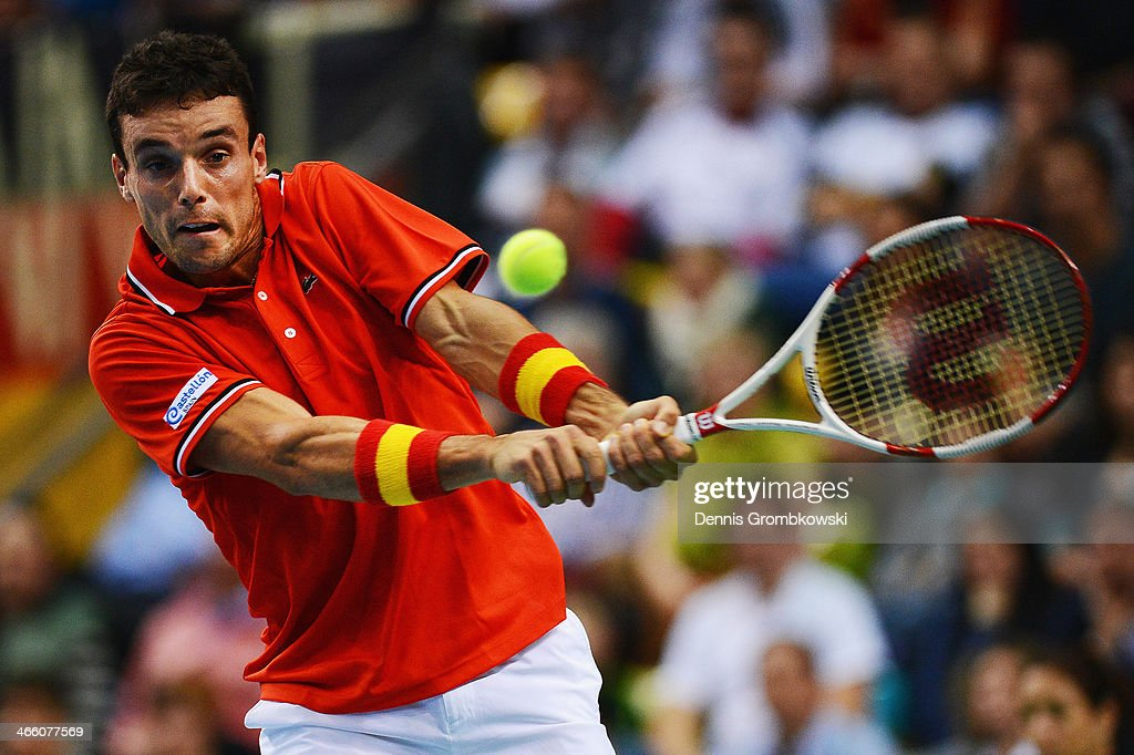 Roberto Bautista Agut of Spain plays a backhand in his match against Philipp Kohlschreiber of Germany on day 1 of the Davis Cup First Round match between Germany and Spain at Fraport Arena on January 31, 2014 in Frankfurt am Main, Germany.