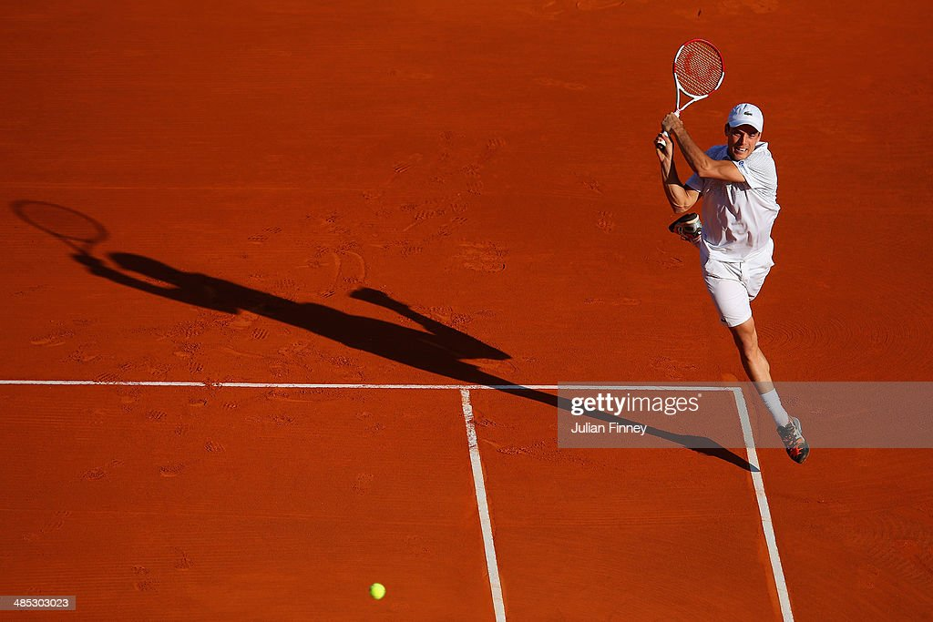 Roberto Bautista Agut of Spain plays a backhand with partner (out of frame) Andreas Seppi of Italy against Romain Arneodo and Benjamin Balleret of Monaco in their doubles match during day five of the ATP Monte Carlo Rolex Masters Tennis at Monte-Carlo Sporting Club on April 17, 2014 in Monte-Carlo, Monaco.