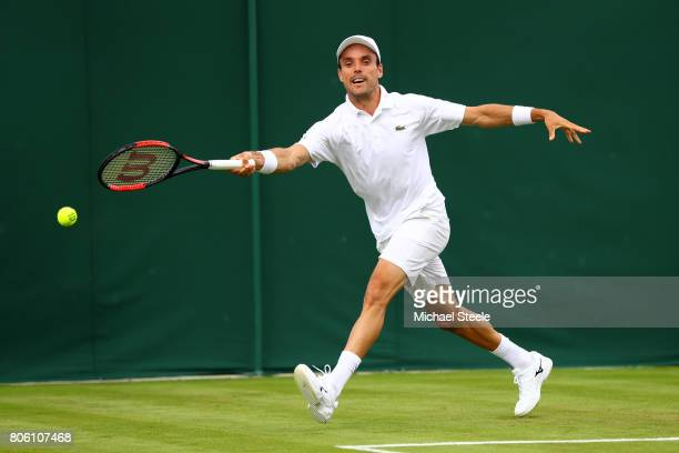 Roberto Bautista Agut of Spain plays a forehand during the Gentlemen's Singles first round match against Andreas HaiderMaurer of Austria on day one...