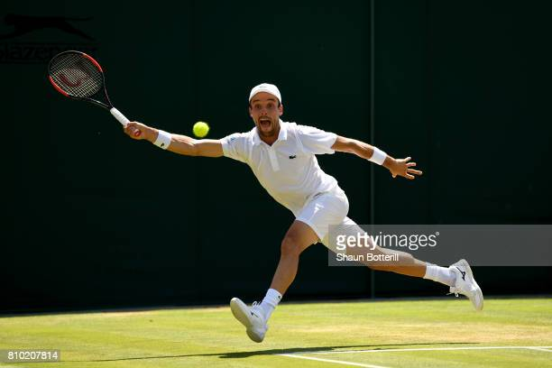 Roberto Bautista Agut of Spain plays a forehand during the Gentlemen's Singles third round match against Kei Nishikori of Japan on day five of the...