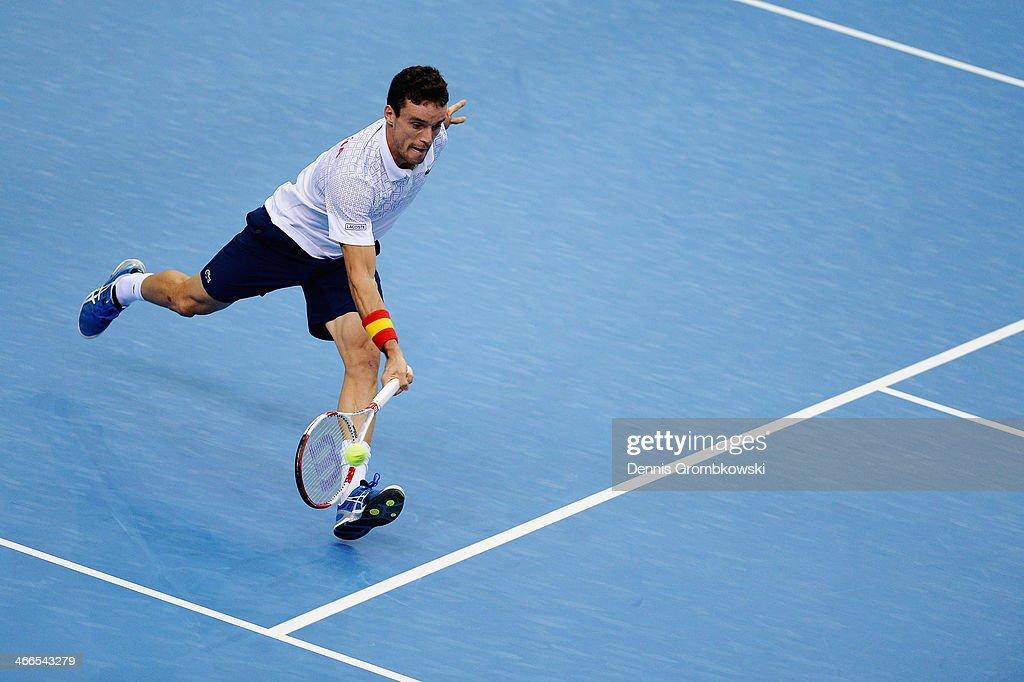 Roberto Bautista Agut of Spain plays a forehand in his match against Daniel Brands of Germany on day 3 of the Davis Cup First round match between Germany and Spain at Fraport Arena on February 2, 2014 in Frankfurt am Main, Germany.