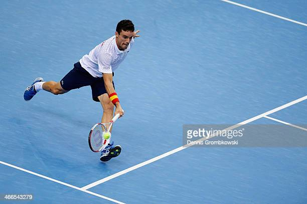 Roberto Bautista Agut of Spain plays a forehand in his match against Daniel Brands of Germany on day 3 of the Davis Cup First round match between...