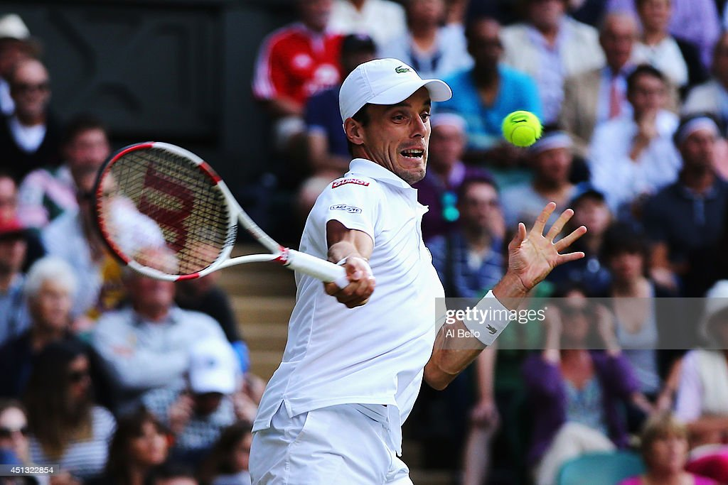 Roberto Bautista Agut of Spain plays a forehand return during his Gentlemen's Singles third round match against Andy Murray of Great Britain on day five of the Wimbledon Lawn Tennis Championships at the All England Lawn Tennis and Croquet Club on June 27, 2014 in London, England.