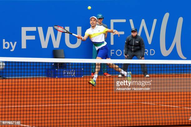 Roberto Bautista Agut of Spain plays the ball against Marius Copil of Rumania during their 2 round match of the 102 BMW Open by FWU at Iphitos tennis...